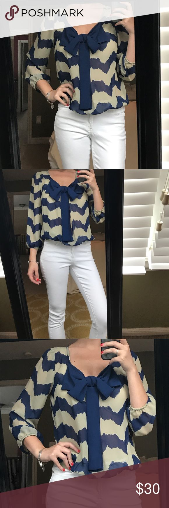 Chevron Blouse Gray and navy blue chevron blouse. Front bow. Sinched bottom. 3/4 sleeves. Rachel & Chloe Tops Blouses