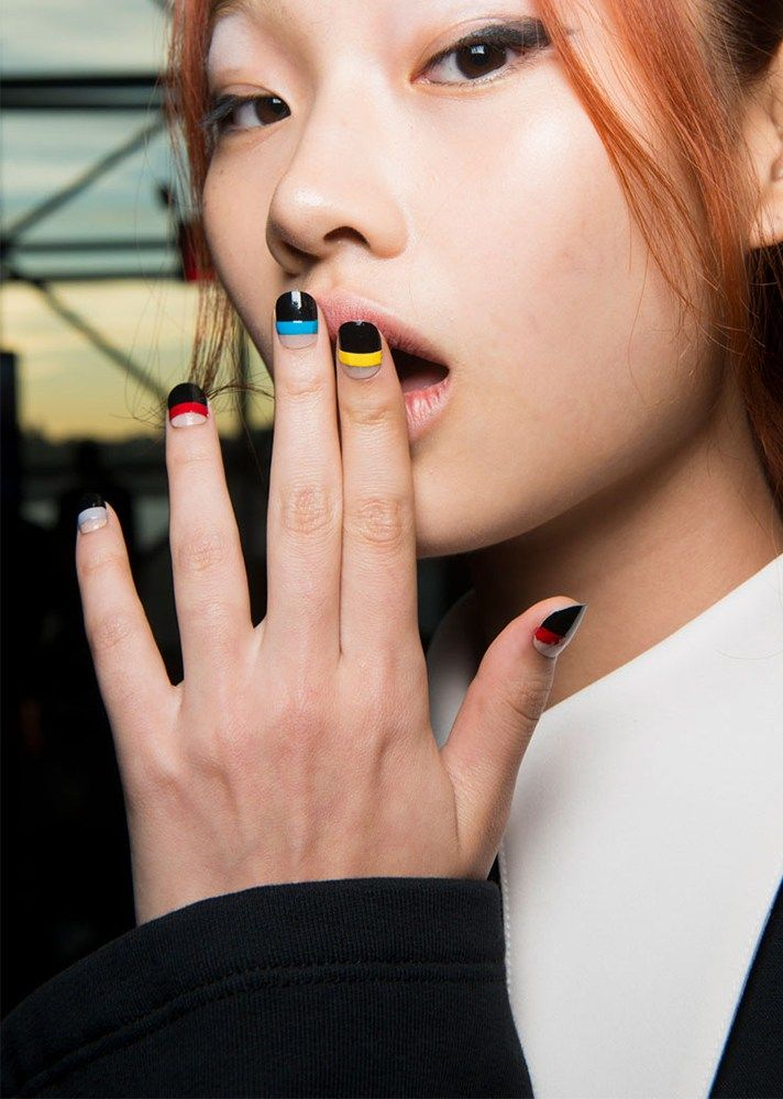 Browse the best nail art ideas from fashion month Spring 2017 at @StyleCaster | Opening Ceremony's black nails with colorful stripes