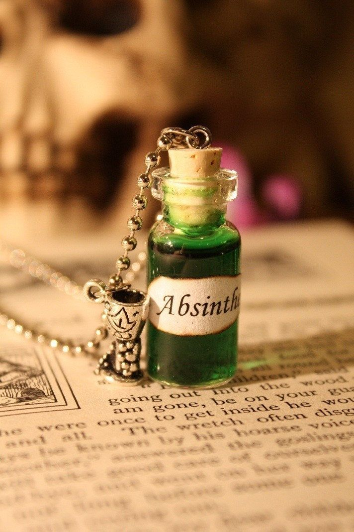 I have some little vials like that, I may need to make myself a little absinthe pendant!