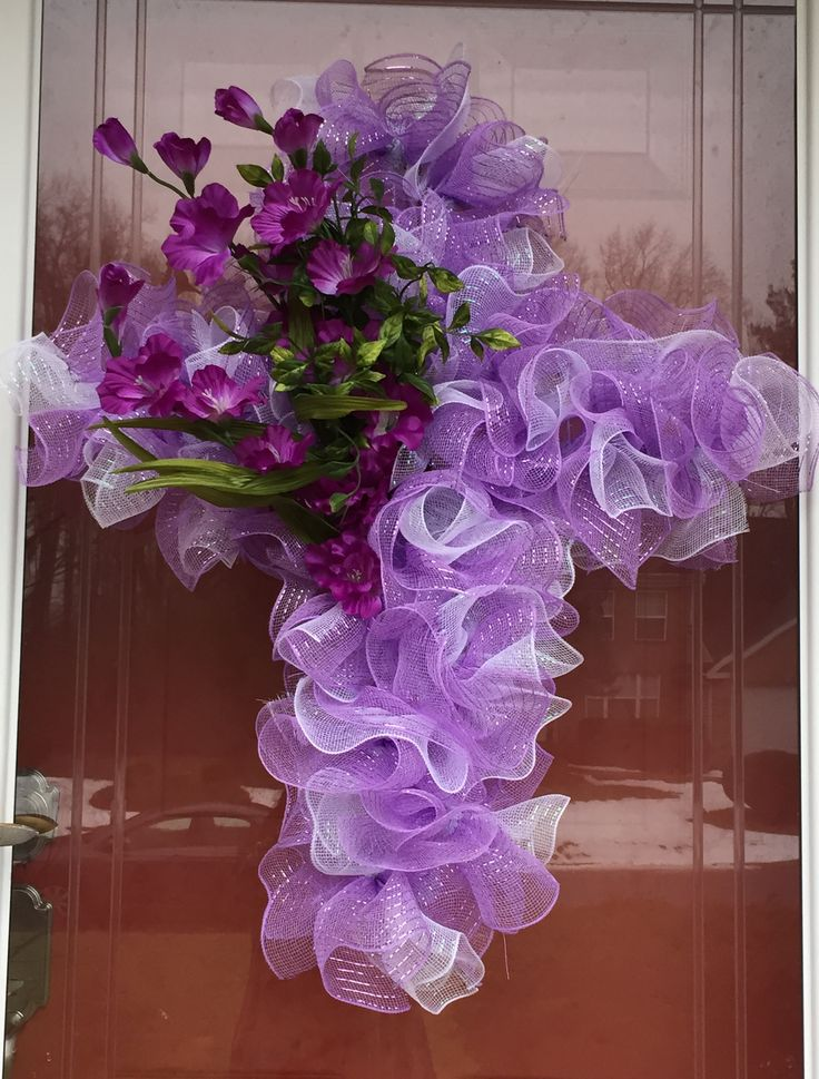 Easter Cross Deco Mesh Wreath. Very elegant cross made with purple and white mesh, with offset of purple gladiolus. Inquire at Catching Rays Decor on Facebook and Etsy for your custom wreath. https://www.facebook.com/Catching-Rays-Home-Decor-124934951179779/
