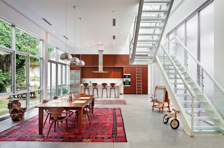 Gorgeous open plan dining room with stylish kitchen island and fancy bar stools next to edgy wooden dining set under groovy metal pendant lamps: lofty and airy brooklyn artist loft by bwarchitects