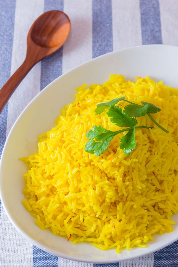 Aside from turmeric and saffron, some good chicken stock and onions are all you need to make this Arroz Amarillo recipe into a stunning side dish that tastes as good as it looks.