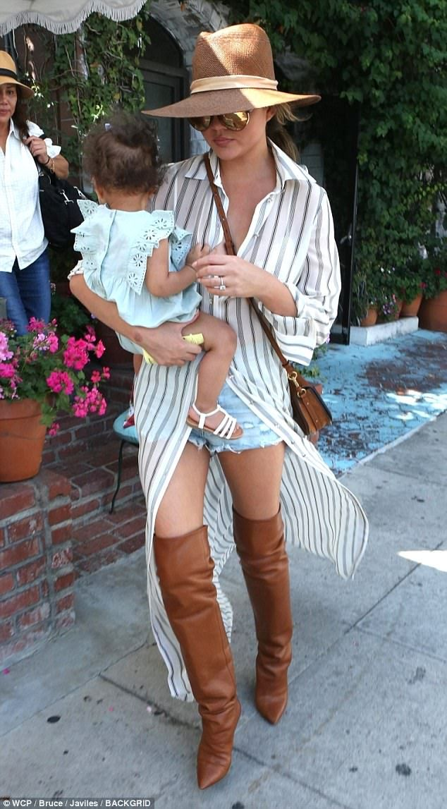 Stunning: Chrissy was casual chic in a denim cuts off and a big fedora as her baby girl played on the floor of the celebrity hotpot The Ivy restaurant.