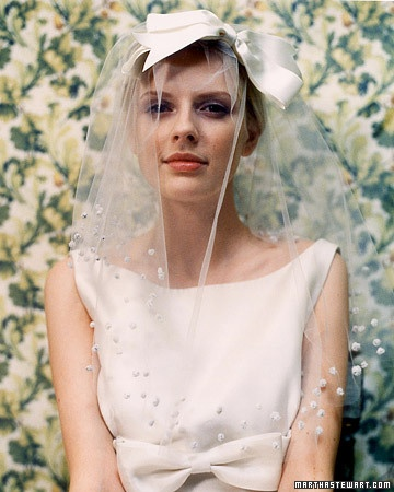 Wearing your hair up? Accent it with a cute retro ribbon headpiece like this. -- kind of like the idea, but not too sure of it...