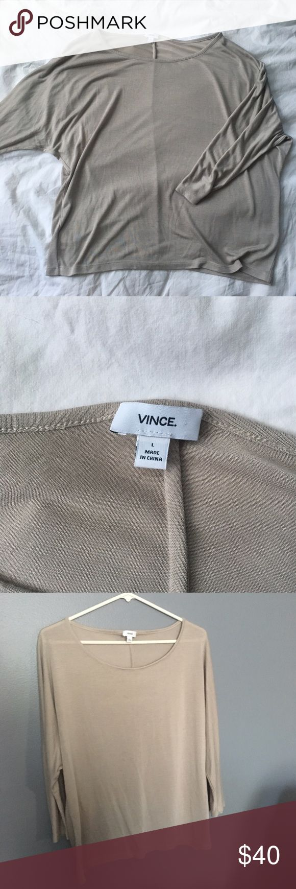 Vince beige tee This tee is super comfortable and versatile with any style and outfit! Super lightweight and soft, the inner tag has fallen off so I'm not sure what the material composition is. Slight batwing sleeve; tightens at the elbow, loosens at the shoulder. Wide scoopneck. Great condition! No flaws! Vince Tops Tees - Long Sleeve