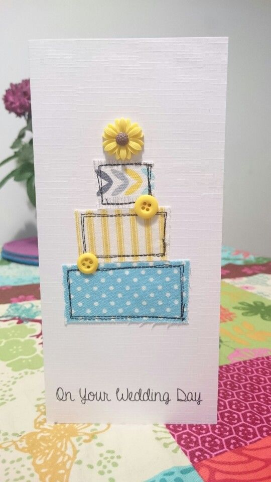 Handmade applique fabric card. Blue and yellow wedding cake.