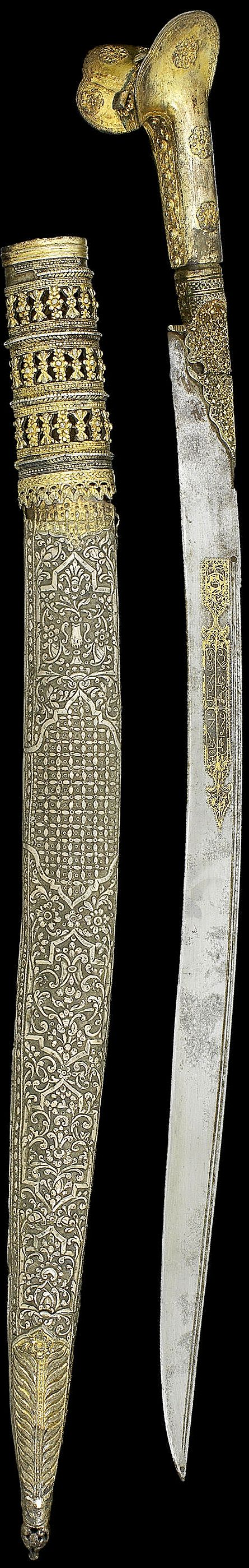 """Ottoman yatagan, 19th c, gold inlaid blade, silver-gilt grip and scabbard with filigree rosettes to sides and pommel, repousse silver scabbard with cartouches on a floral ground, gilded terminal and upper, 74.5cm. Inscribed:owner """"Asıl(?) Agha"""",  the dog of the Seven Sleepers """"Qitmir""""; other side """"bıcak elde gerek / delde sübhan tawakkuli 'ala khaliqi / ghayrat [?] ahmad"""", """"In the hand one must have a dagger, and 'Praise Him!' in one's heart, my dependance is on my creator Ghayrat [?]…"""