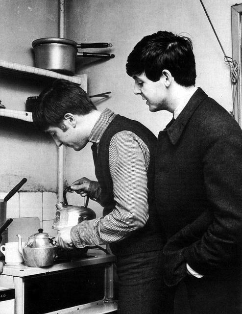 John Lennon making tea after school in the McCartney family kitchen