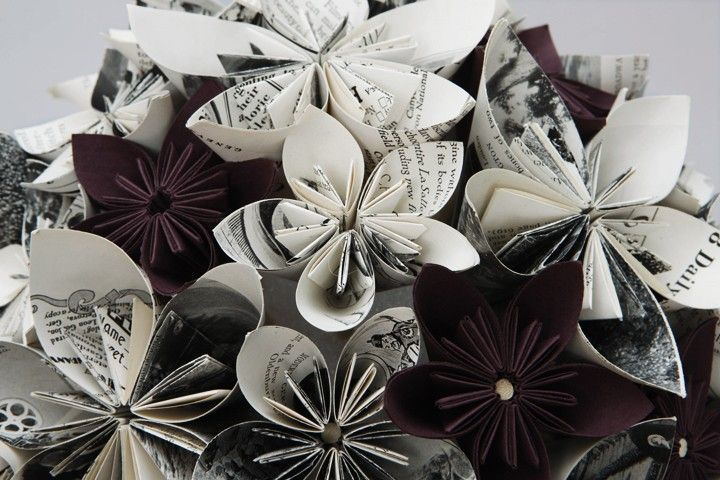I love paper flowers! you can use all patterns of scrapbook paper, newspaper, whatever you feel like. make it your own style!