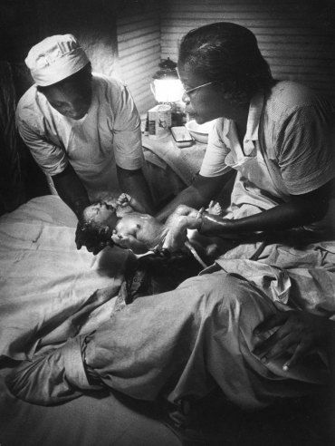 """Maude Callen on duty. In December 1951, LIFE published one of the most extraordinary photo essays ever to appear in the magazine. In W. Eugene Smith's pictures, the story of a tireless South Carolina nurse and midwife named Maude Callen working in the rural South in the 1950s. She served as """"doctor, dietician, psychologist, bail-goer and friend"""" to thousands of poor (most of them desperately poor) patients. (click through to see more. rw)"""
