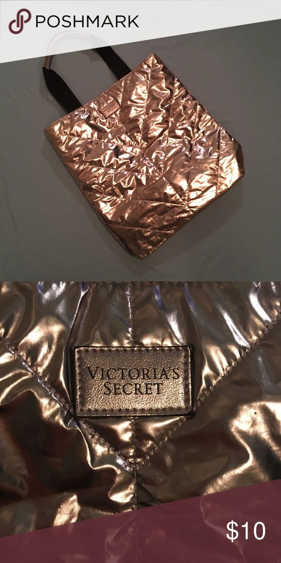 Victoria's Secret Gold Tote Llimited edition gold tote bag from VS! It is shiny and iridescent! Perfect size for carrying a laptop and notebooks or use as an overnight bag or everyday purse! In perfect condition! Victoria's Secret Bags Totes