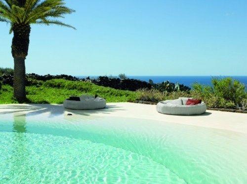 tropical pool that looks like the beach.