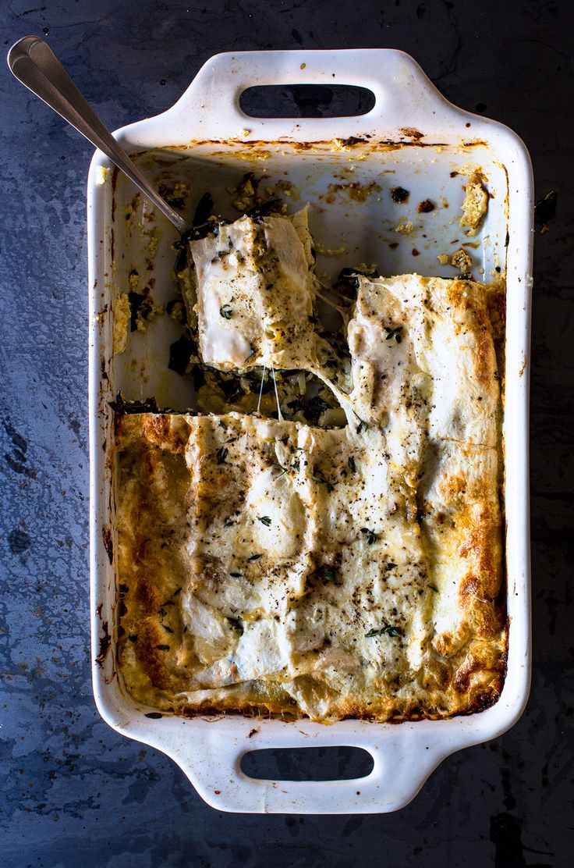A decent amount of béchamel keeps this tomato-less lasagna moist as it cools.