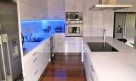 This kitchen is an entertainers delight with it's island bench, 2 large fridge/freezers, hard wearing laminate door finish and gorgeous stone benchtop, the blue strip lighting sets it all off!