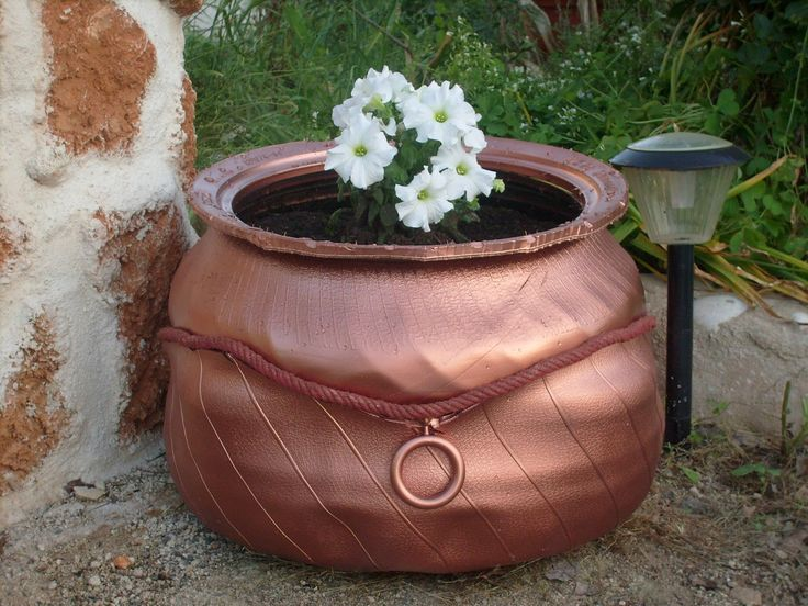 Nice idea for a planter to combine tires into one pot for Using tyres as planters