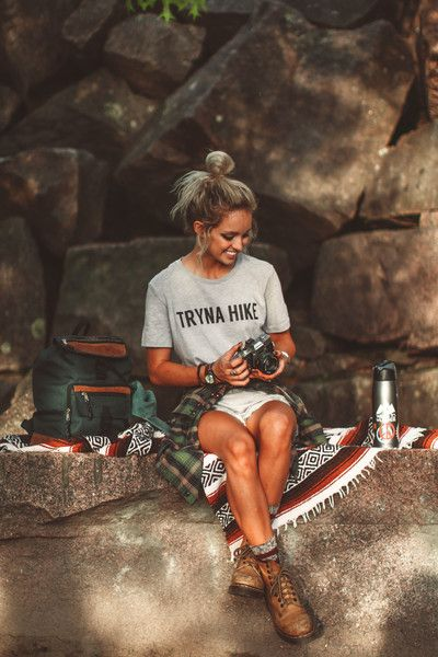 Tryna Hike, always. Women's gray tee made of 90% combed and ring-spun cotton and 10% poly. Go with your normal size for a relaxed fit. Hailey is wearing a Medium. Photos by Bryce Miller of Hailey Mari                                                                                                                                                      More