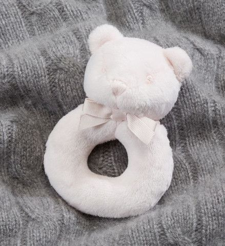 Ralph Lauren Baby Girl Bear Rattle  This little delicate pink rattle bear from Ralph Lauren will surely be your girl's best friend for a very long time. Give him a little jiggle and you here a soothing rattle. Perfect friend for cot time and comforter for the night. Very special gift to give to a newborn baby. All cuddly and soft!
