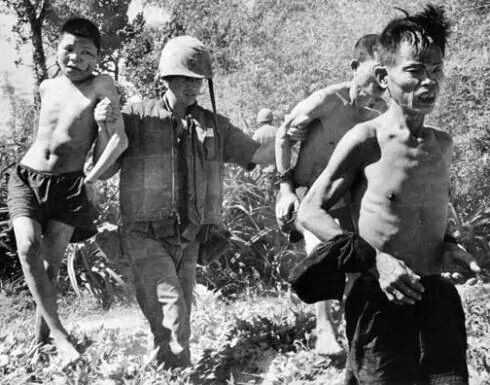Vietnam...a US Marine with 3 VC prisoners