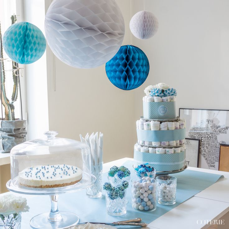 It's a boy! Decoration ideas for a baby shower.  A classic diaper cake was the centerpiece of the table. <3 A home-made white chocolate cheese case was everybody's favorite. :) And honeycomb paper balls gave the final touch for the decoration!   Check out the whole blog post here: http://www.coterie.fi/baby-shower-for-a-boy-vauvakutsut-pojalle/
