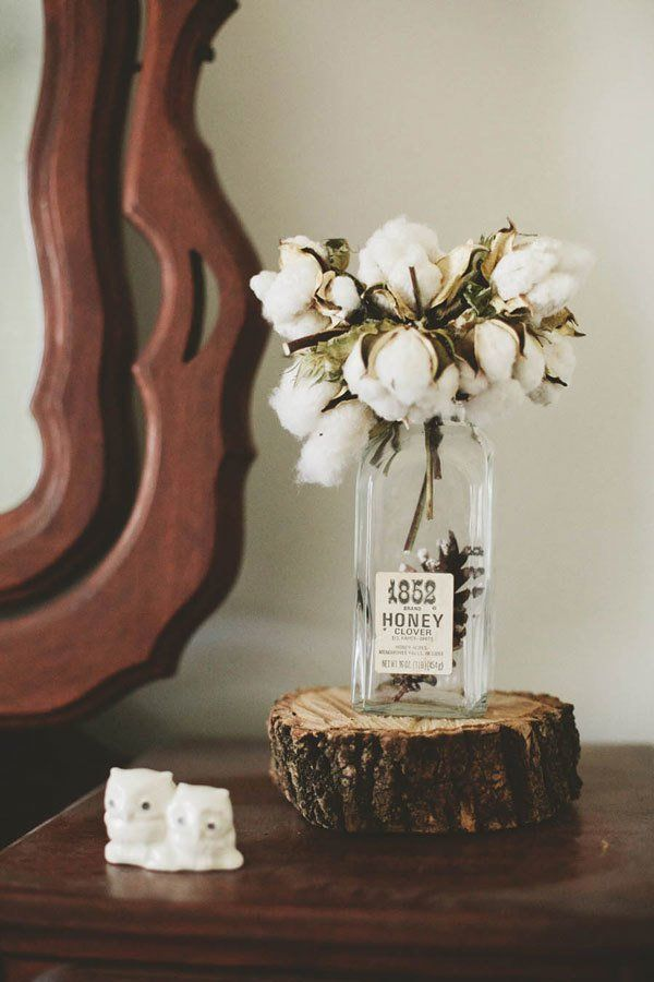 Raw cotton boll arrangement at rustic wedding.