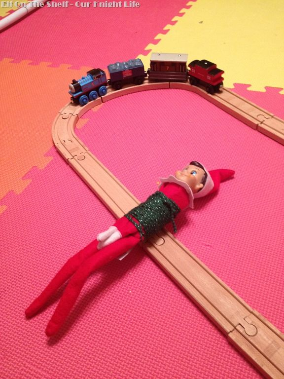 Stuck on his back with a crack in the track! #thomasthetrain meets #elfontheshelf - Elf on the Shelf ideas from @OurKnightLife