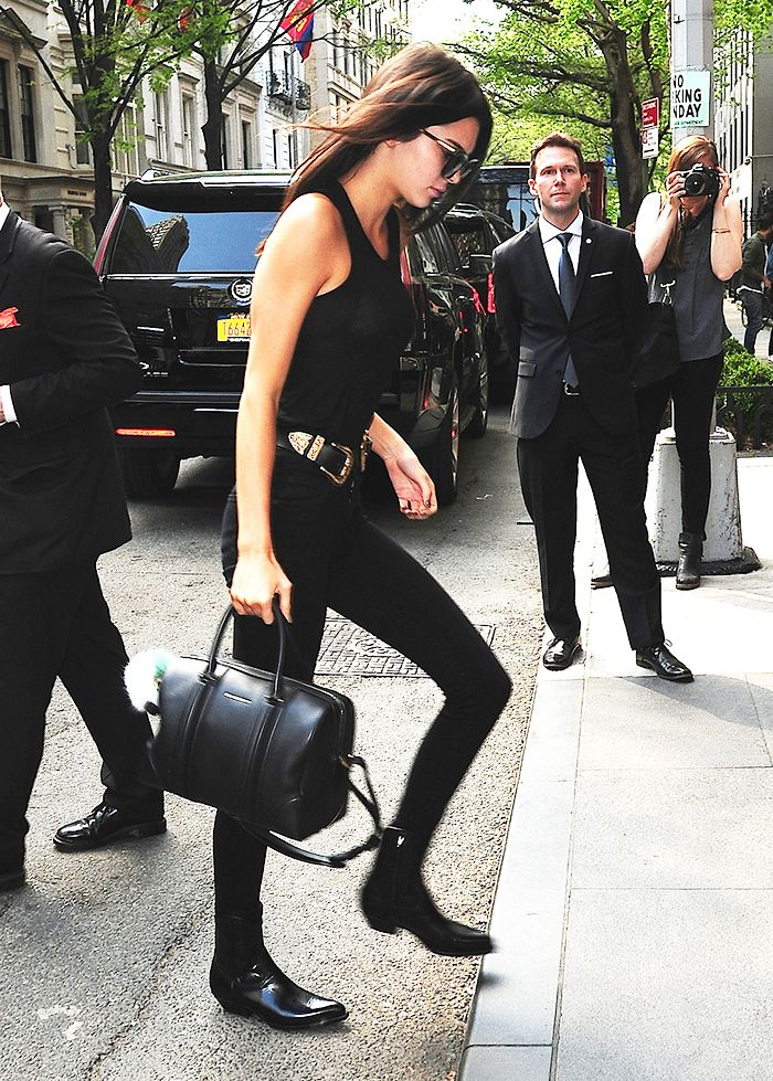 Kendall Jenner in a black pants, a black tank, and black western boots