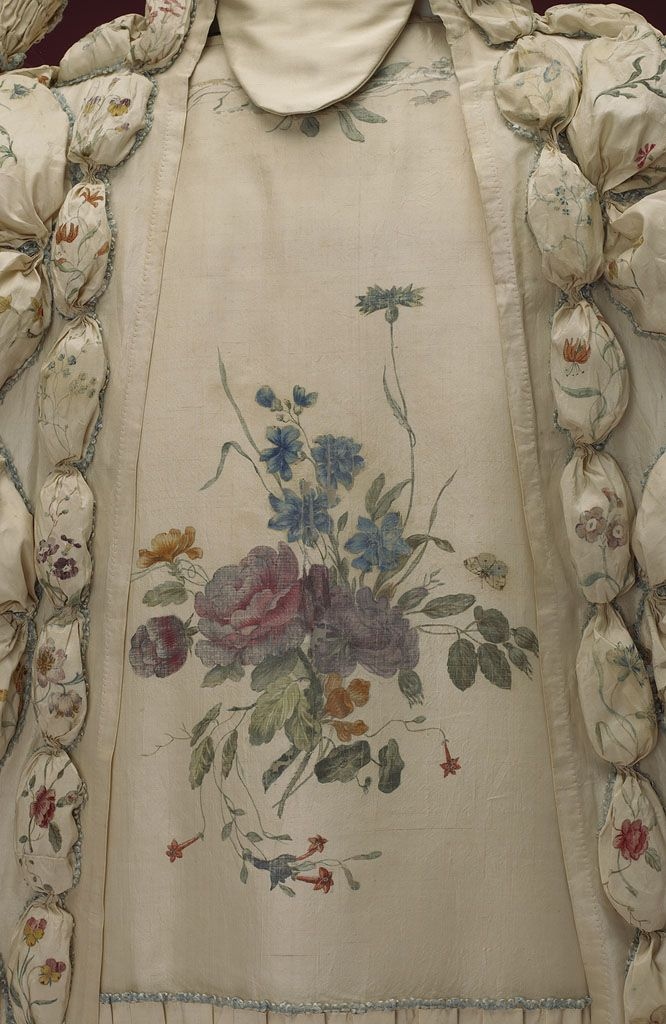 Detail front, robe à la francaise, 1740-1760. Cream silk, beautifully hand-painted with floral motifs, flower sprays, birds and insects; self-fabric trimming, linen lining.