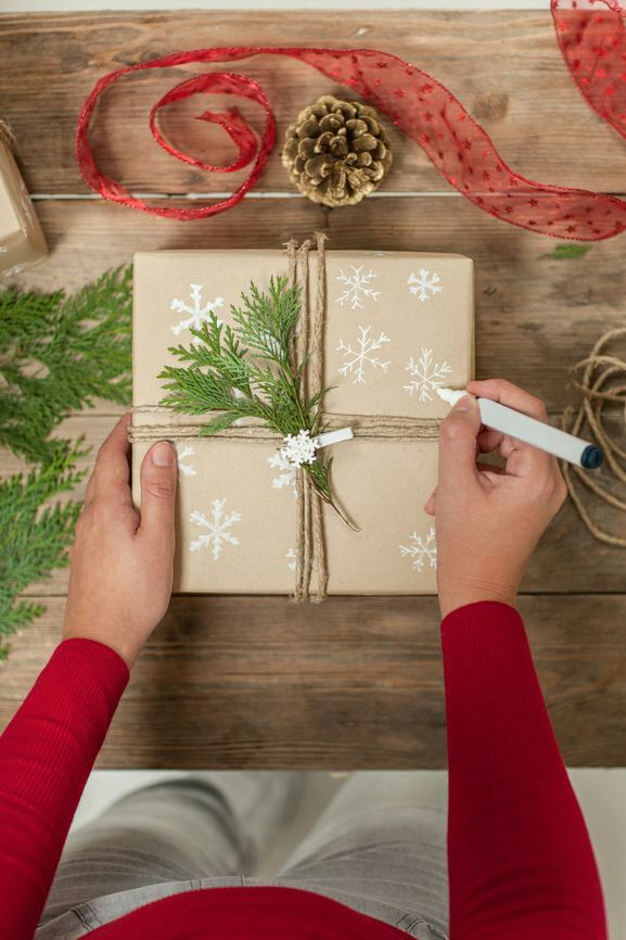 wrapping: paint pen + butcher paper + twine + greenery from yard
