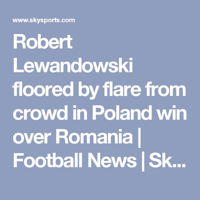 Robert Lewandowski floored by flare from crowd in Poland win over Romania | Football News | Sky Sports