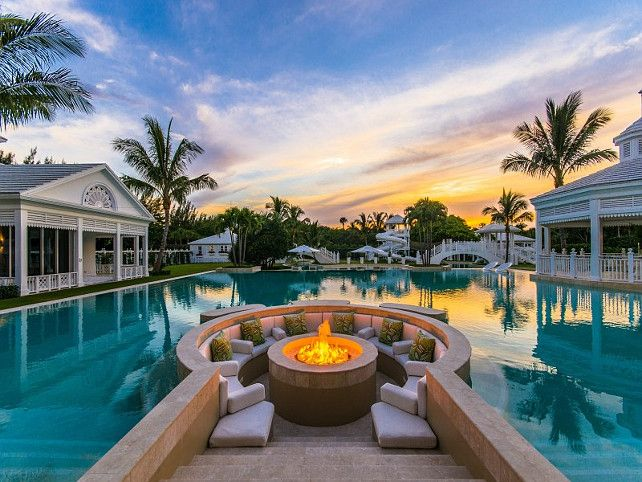 Celion Dion's 'backyard' is one of a kind. This firepit has spectacular views of the water that surrounds her entire mansion.  #celebrity #celebrityhomes #smarthomesforliving