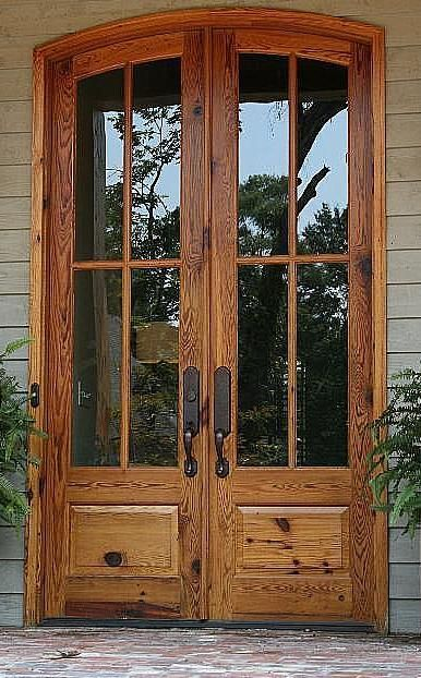 Heart pine entry doors – I like the feel of these without the arch and one single, wide heavy door.