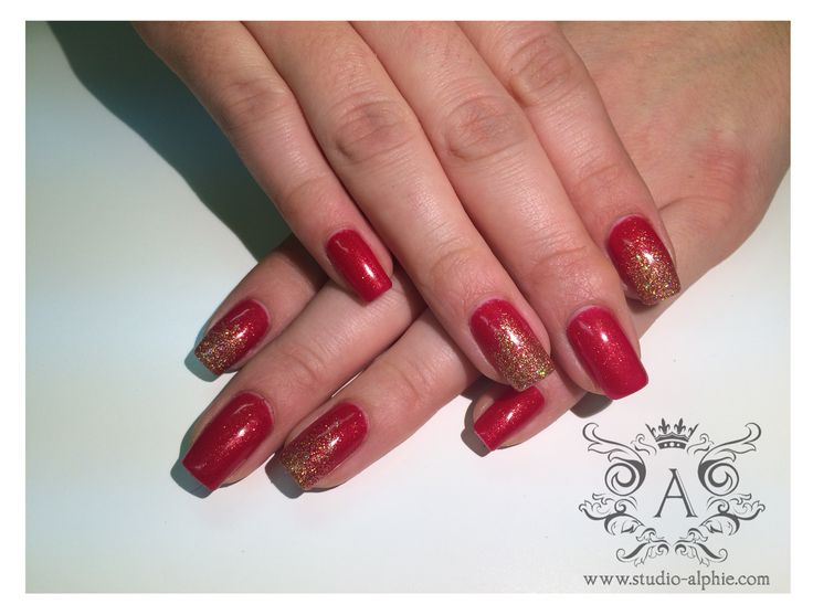 Red gelish with gold glitter.