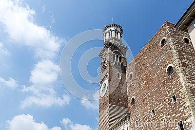 Beautiful old palace on historical Piazza delle Erbe with Lamberti tower, Verona, Italy.