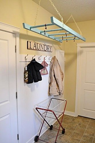 yellow walls, blue accents.......such a neat idea!! paint an old ladder(or crib rail) a color of your choice & hang from the ceiling in the laundry room for hanging clothes that need to air-dry!! no more clogging every doorway in your house & a great way to add a pop of color or unique decorative flare to your laundry room!