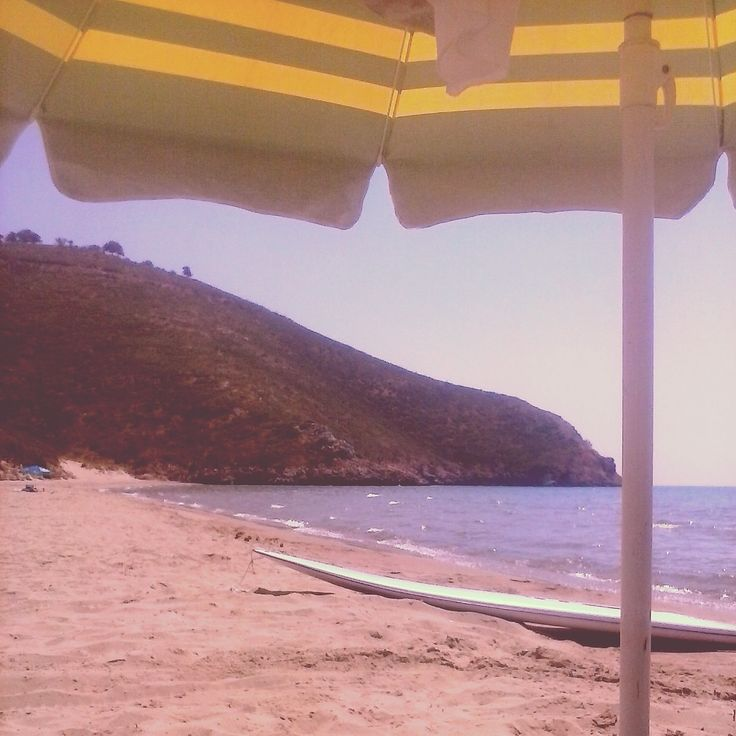 under my umbrella at gianniskari beach!