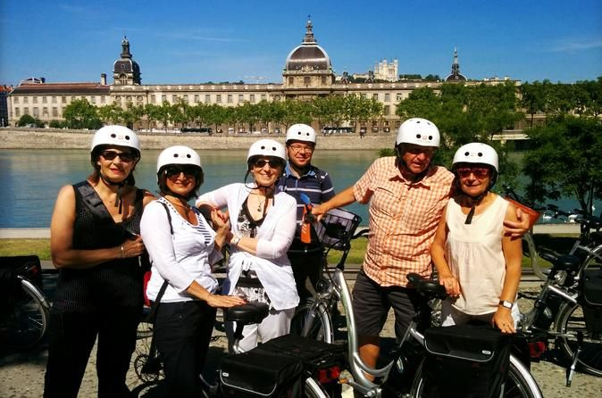 Gourmet Electric Bike Tour of Lyon Travel the city in style and enjoy a taste of France's culinary capital on this 4-hour gourmet electric bike tour of Lyon. Spin through Lyon effortlessly by electric bike with your guide. Discover top city attractions such as the UNESCO–listed Old Town, Place Bellecour, Parc de la Tête d'Or and the banks of the Rhône River. Visit Les Halles de Lyon Paul Bocuse food market and gain insight into Lyon's amazing culinary heritage with food an...