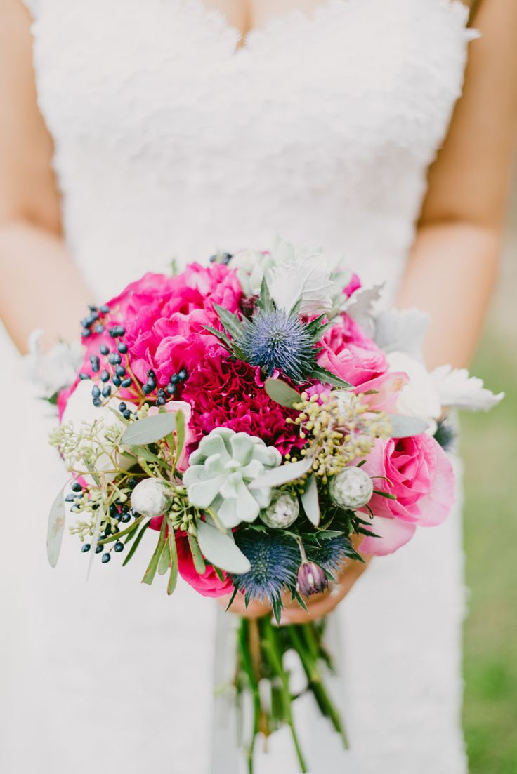 Absolutely in love with this bright bridal bouquet of hot pink blooms, blue thistles, and succulents!