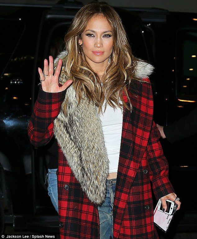 P,layful plaid: Jenifer was seen taking a stroll around chilly Manhattan with her sister Lynda Lopez, dressed in a lumberjack-style plaid jacket with fur collar