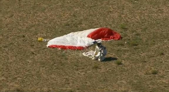 Baumgartner LandsCredit: Red Bull StratosFelix Baumgartner kneels on the ground after landing safely from the highest skydive ever.
