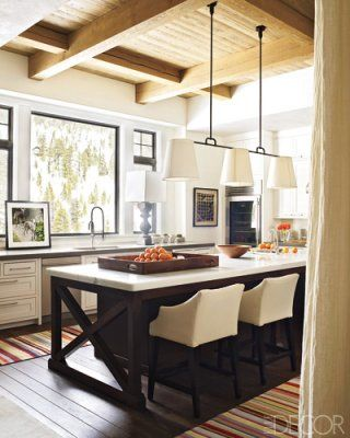Elle Decor ~ Dornbracht sink fittings; countertops are of Calacatta marble, stools by Lee Industries, custom light fixture is by Roman Thomas.