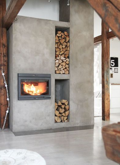 modernize a loft space with a dramatic concrete fireplace | Apartment Therapy