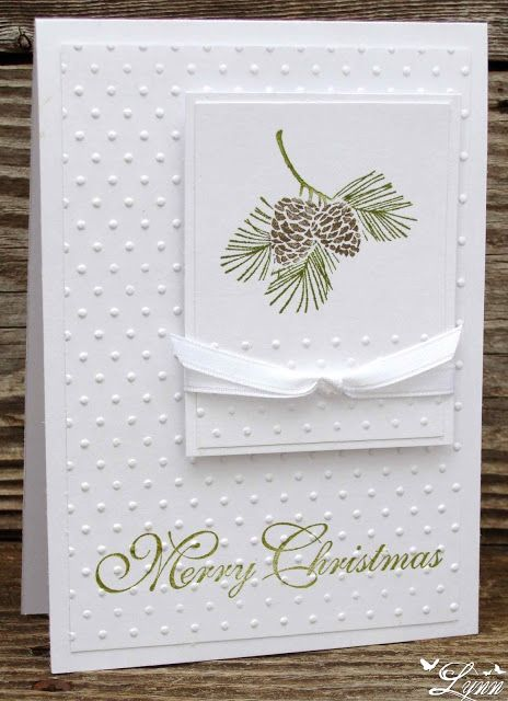 """By Lynn. Stamp sentiment on 5 1/4"""" x 4"""" white cardstock panel; then dry emboss in """"Swiss Dots"""" Cuttlebug folder. Pop up onto white card base. Stamp pine branch from """"Autumn Accents"""" (Stampin' Up) near top of smaller white panel; then dry emboss the bottom third of the panel, same folder as above. Mat on white panel; add ribbon. Pop up image piece onto card. Card easily mass produced."""