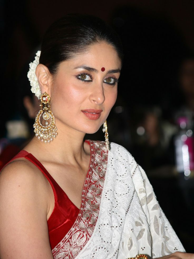 Kareena Kapoor dazzles in a chikankari white sari paired up with a sleeveless red blouse.