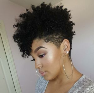 Love this natural hair style. Curl, side shaved down and volume.