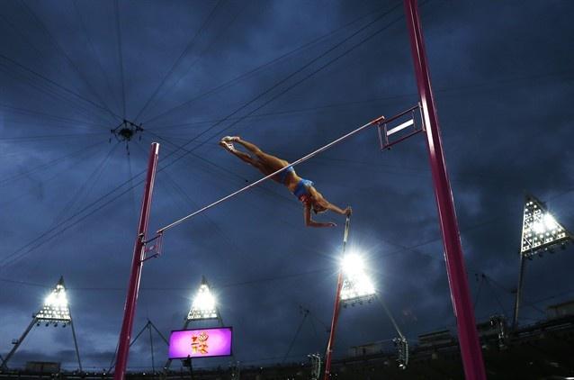 Russia's Yelena Isinbayeva clears the bar in the women's pole vault finalin the Olympic Stadium.
