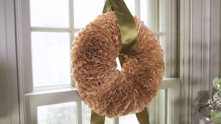 Martha makes a gorgeous wreath using unbleached coffee filters folded to create a ruffled effect. Tied with a contrasting jewel-toned ribbon, it's pretty hung in a window or on your front door.