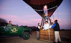 Hot air balloon taking off at dawn