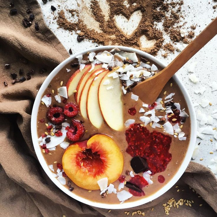 It's a cacao-coconut smoothiebowl with a whole lot of goodness! Toppings include apple, nectarine, coconut, cacao nibs, homemade raspberry chia jam & flaxseeds ~ RAW, VEGAN & REFINED SUGAR FREE!