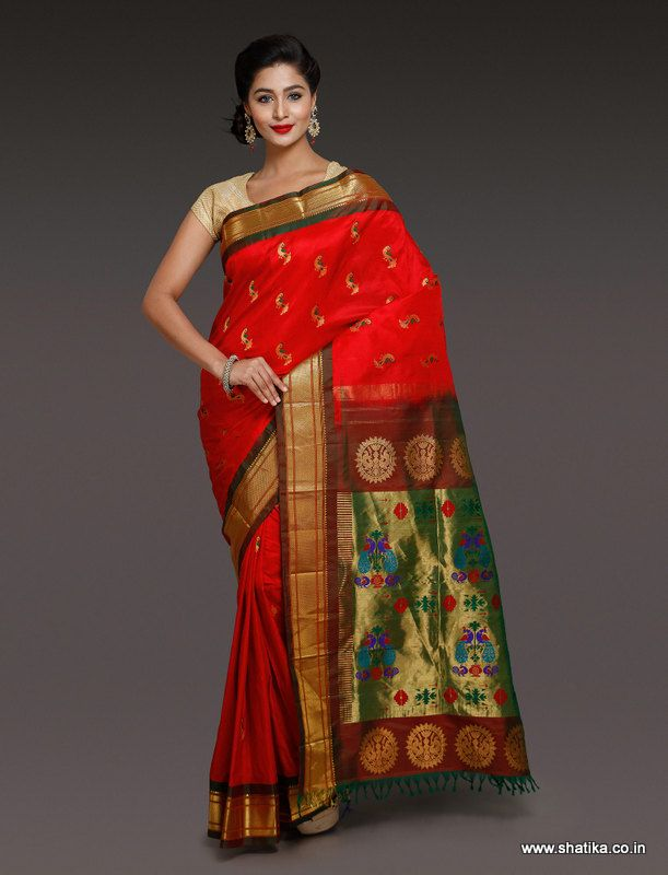 Mor bootis all over the body, Caaveri Royal Red Paithani Silk Saree is here to add charm and appeal to your silken collections. Woven in the Paithan village of Maharashtra, this pure silk saree with zari details is capable of turning heads around. A rage among paithani sarees online, this piece is woven by the master weaver Ambadas Akbote of Paithan.