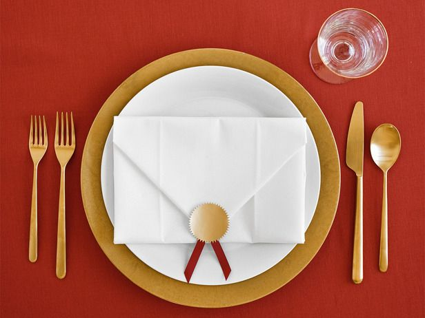 """Nominee Napkin  """"Turn paper napkins into Oscar envelopes with a gold seal, red ribbon and some clever folding: Open the napkin and lay it flat; fold in the top two corners to form a triangle. Fold the bottom edge of the napkin up until it meets the base of the triangle, then fold the top triangle down and seal."""" (Food Network Magazine) clever idea for theme evenings"""